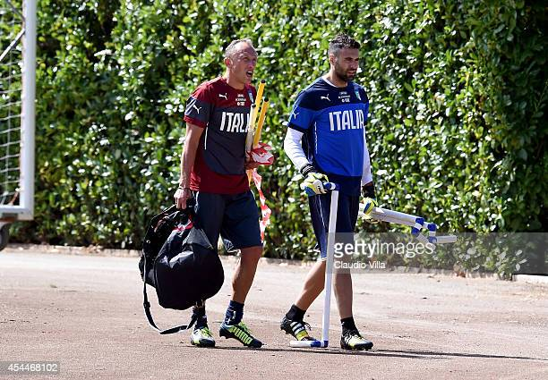 Goalkeeping coach Gianluca Spinelli and Salvatore Sirigu during an Italy training session at Coverciano on September 1 2014 in Florence Italy