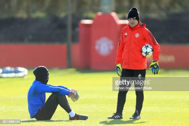 Goalkeeping coach Silvino Louro talks to Man Utd goalkeeper David De Gea during a training session ahead of their UEFA Champions League match against...