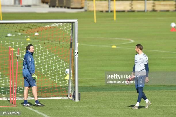 Goalkeeping coach Toni Tapalovic of Bayern Muenchen talks to goalkeeper Manuel Neuer during a training session at Saebener Strasse training ground on...