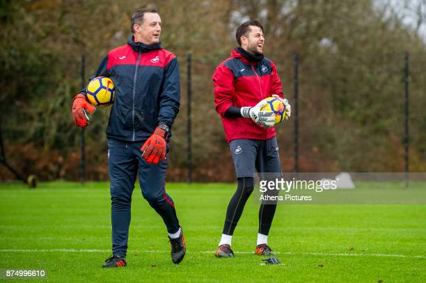 Goalkeeping coach Tony Roberts and Lukasz Fabianski in action during the Swansea City training session at The Fairwood training Ground on November 16...