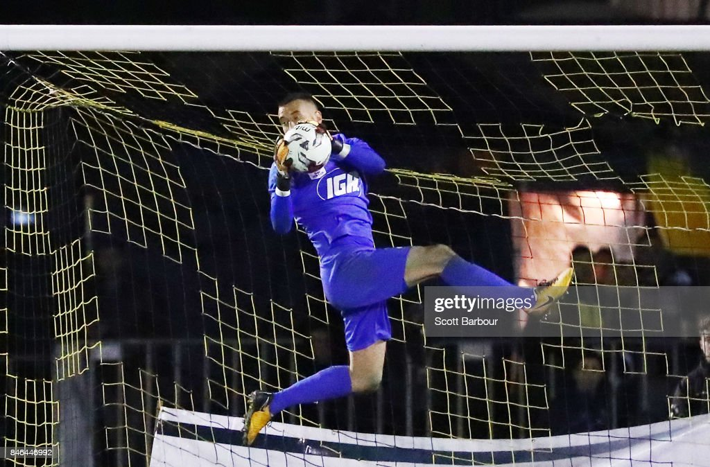Goalkeepr Paul Izzo of Adelaide United makes a save during the FFA Cup Quarter Final match between Heidelberg United FC and Adelaide United at Olympic Village on September 13, 2017 in Melbourne, Australia.