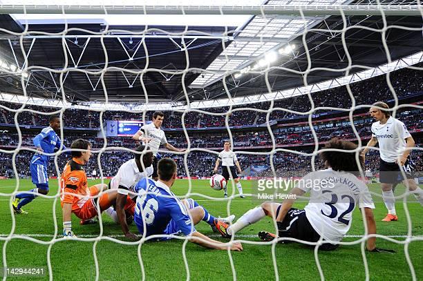 Goalmouth scramble involving Carlo Cudicini of Tottenham Hotspur Ledley King of Tottenham Hotspur John Terry of Chelsea and Benoit AssouEkotto of...