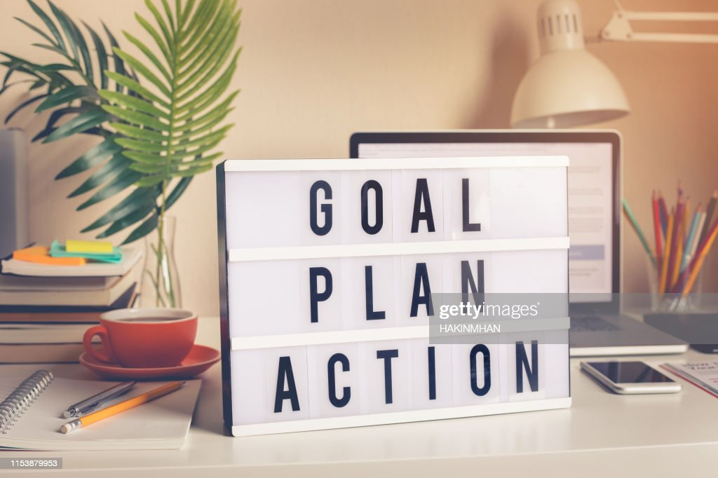 Goal,plan,action text on light box on desk table in home office : Stock Photo