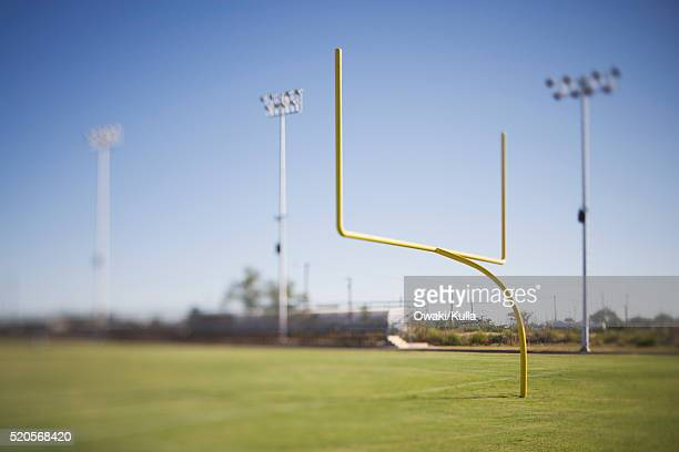 goalpost on empty football field - goal post stock pictures, royalty-free photos & images