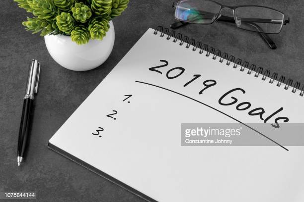 2019 goals on notebook. new resolution list. - 2019 stock pictures, royalty-free photos & images