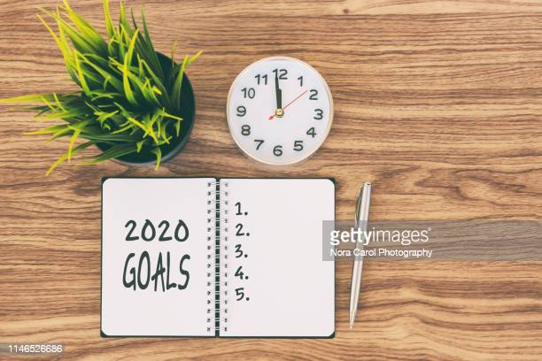 2020 goals text on note pad - happy new year 2020 stock photos and pictures