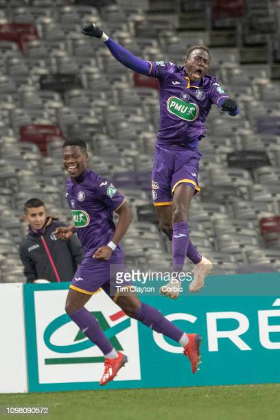 Goalscorer Aaron Leya Iseka of Toulouse and Issiaga Sylla of Toulouse celebrate their sides third goal during the Toulouse FC V Stade de Reims Coupe...