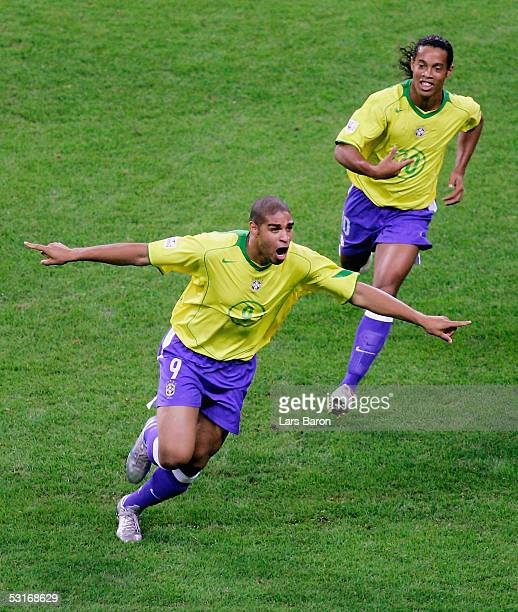 Goalscorer Adriano of Brazil celebrates with team mate Ronaldinho during the FIFA 2005 Confederations Cup Final between Brazil and Argentina at the...