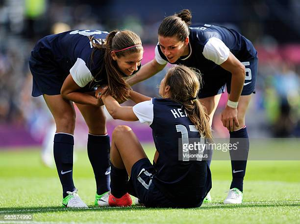 USA goalscorer Alex Morgan and Kelley O'Hara thank provider Tobin Heath during the womens Group G football match between USA and France as part of...
