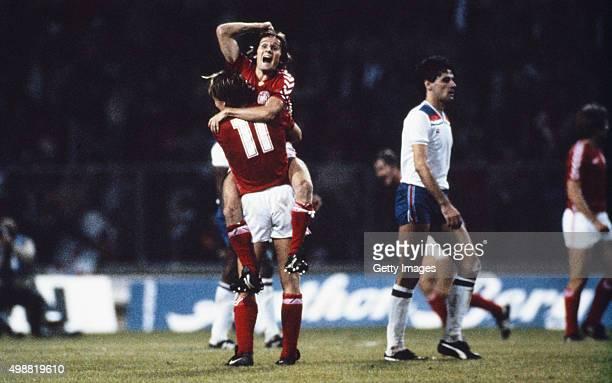 Goalscorer Allan Simonsen celebrates with Klaus Berggreen as England defender John Gregory looks on after Denmark had beaten England 10 in their...