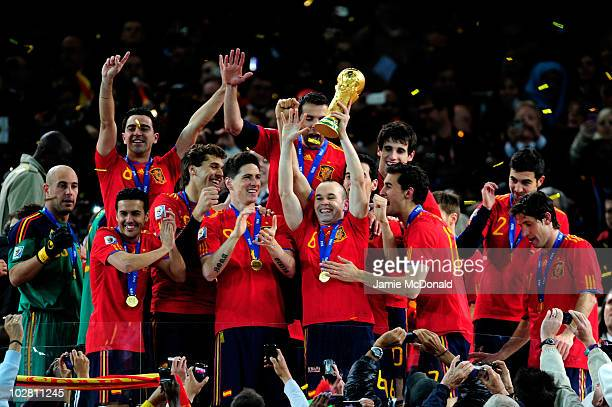 Goalscorer Andres Iniesta of Spain celebrates as he lifts the World Cup with team mates during the 2010 FIFA World Cup South Africa Final match...