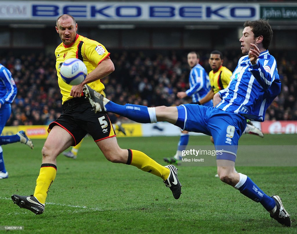 Goalscorer Ashley Barnes of Brighton controls the ball as Martin Taylor of Watford looks on during the FA Cup Sponsored by E.ON 4th Round match between Watford and Brighton & Hove Albion at Vicarage Road on January 29, 2011 in Watford, England.