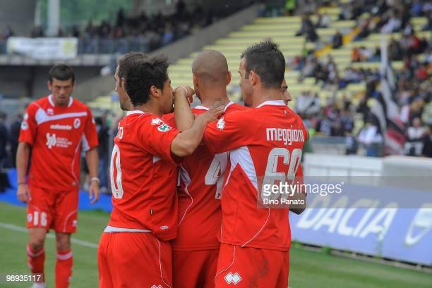 Goalscorer Bernardo Sergio Almiron of AS Bari is congratulated by Riccardo Meggiorini and teammates during the Serie A match between Udinese Calcio...
