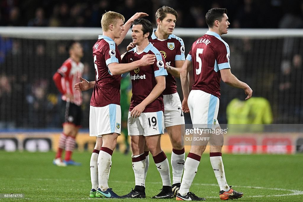 Goalscorer, Burnley's English midfielder Joey Barton (2nd L) celebrates on the pitch with teammates after the English Premier League football match between Burnley and Southampton at Turf Moor in Burnley, north west England on January 14, 2017. Burnley won the game 1-0. / AFP / Oli SCARFF / RESTRICTED TO EDITORIAL USE. No use with unauthorized audio, video, data, fixture lists, club/league logos or 'live' services. Online in-match use limited to 75 images, no video emulation. No use in betting, games or single club/league/player publications. /