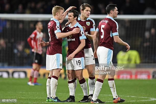 Goalscorer Burnley's English midfielder Joey Barton celebrates on the pitch with teammates after the English Premier League football match between...