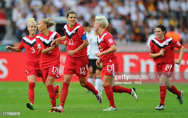 Goalscorer Christine Sinclair is congratulated by team mates during the FIFA Women's World Cup 2011 Group A match between Germany and Canada at...