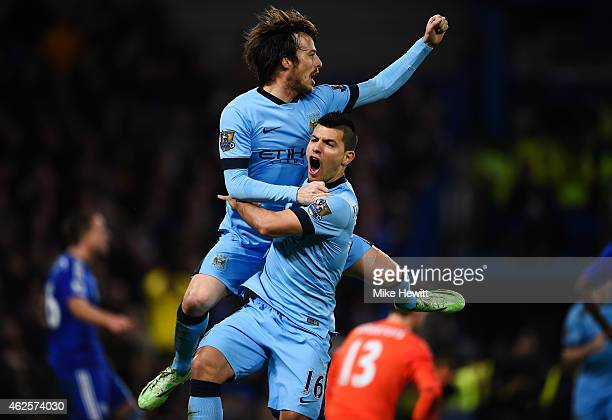 Goalscorer David Silva of Manchester City celebrates with teammate Sergio Aguero after scoring the equalising goal during the Barclays Premier League...