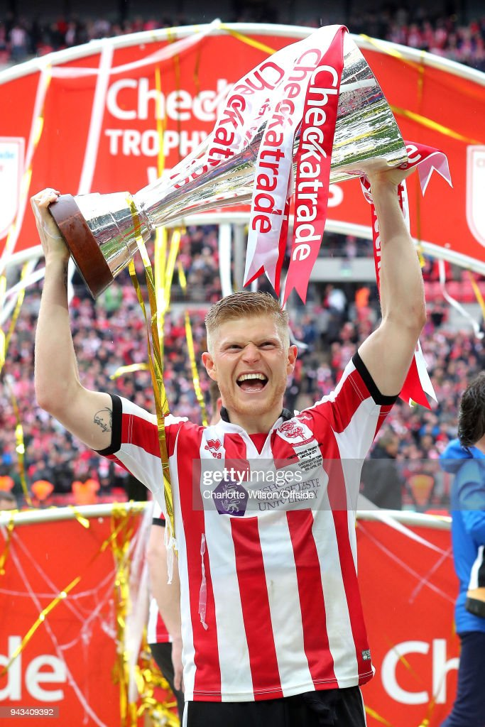 Goalscorer Elliot Whitehouse of Lincoln celebrates with the trophy during the Checkatrade Trophy Final between Lincoln City and Shrewsbury Town at Wembley Stadium on April 8, 2018 in London, England.
