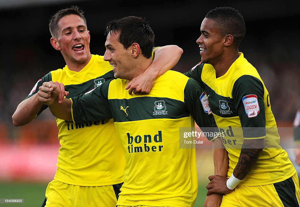 Goalscorer for Plymouth Argyle Maxime Blanchard (C) celebrates with Conor Hourihane (L) and Paris Cowan-Hall (R) during the npower League Two match between Barnet and Plymouth Argyle at Underhill Stadium on October 13, 2012 in Barnet, England.