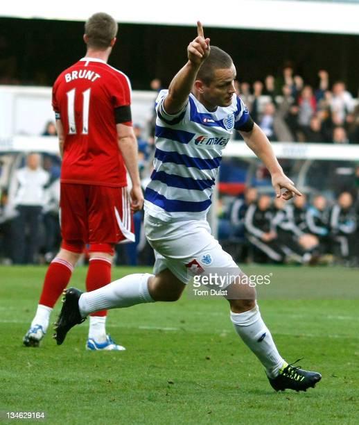 Goalscorer for Queens Park Rangers Heidar Helguson celebrates his opener during the Barclays Premier League match between Queens Park Rangers and...