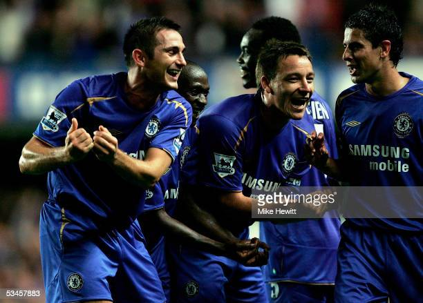 Goalscorer Frank Lampard of Chelsea celebrates the fourth goal and the birth of his baby with team mates during the FA Barclays Premiership match...
