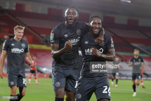 Goalscorer Josh Dasilva celebrates with team-mate Shandon Baptiste of Brentford after he scores a goal to make it 2-0 during the Carabao Cup Second...