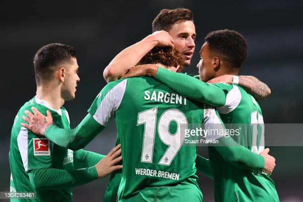 Goalscorer Josh Sargent of Werder Bremen is congratulated by team mates Milot Rashica , Marco Friedl and Felix Agu after scoring his team's second...