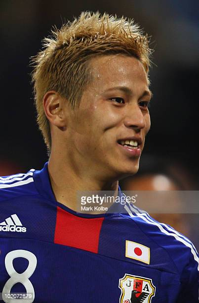 Goalscorer Keisuke Honda of Japan celebrates victory after the 2010 FIFA World Cup South Africa Group E match between Japan and Cameroon at the Free...