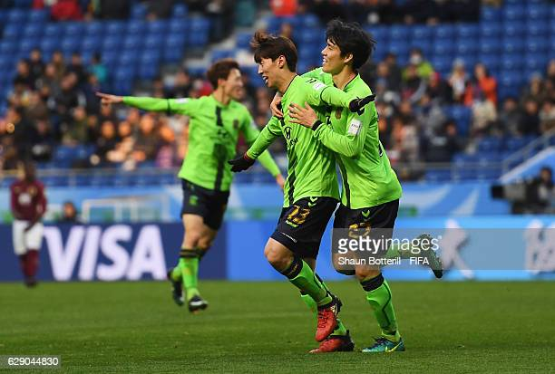 Goalscorer Kim Bokyung of Jeonbuk Hyundai celebrates after scoring the opening goal with Kim Changsoo of Jeonbuk Hyundai during the FIFA Club World...
