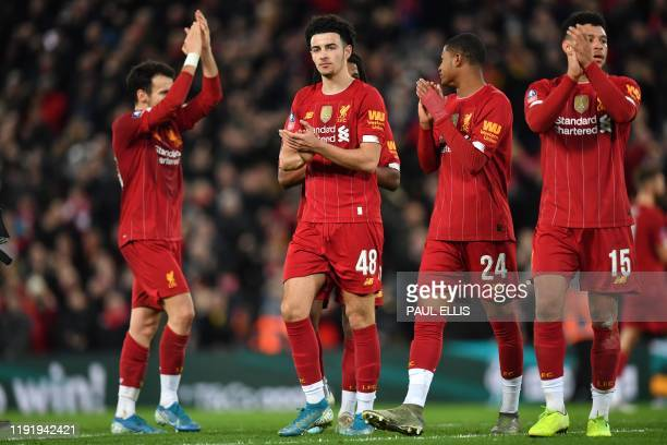 Goalscorer, Liverpool's English midfielder Curtis Jones celebrates with teammates on the pitch after the English FA Cup third round football match...