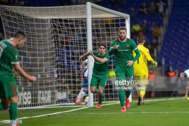 Goalscorer Matt Doherty of Wolverhampton Wanderers acknowledges the assist from Daniel Podence of Wolverhampton Wanderers during the Espanyol V...