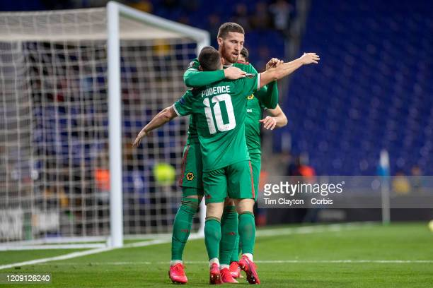 Goalscorer Matt Doherty of Wolverhampton Wanderers acknowledges the assist from Daniel Podence of Wolverhampton Wanderers as they celebrate their...