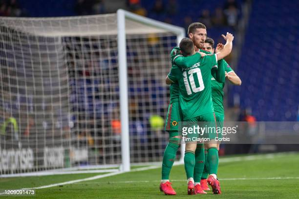 Goalscorer Matt Doherty of Wolverhampton Wanderers celebrates with Daniel Podence of Wolverhampton Wanderers who provided the assist during the...