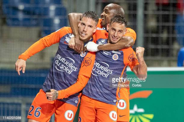 Goalscorer Mihailo Ristic of Montpellier is congratulated by team mate Ruben Aguilar of Montpellier and Souleymane Camara of Montpellier after...