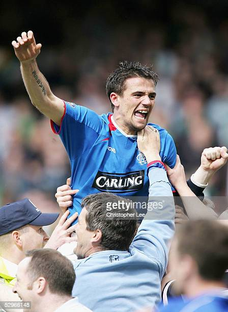 Goalscorer Nacho Novo of Rangers is lifted into the air by the fans as they celebrates winning the Scottish Premier League during the Bank of...