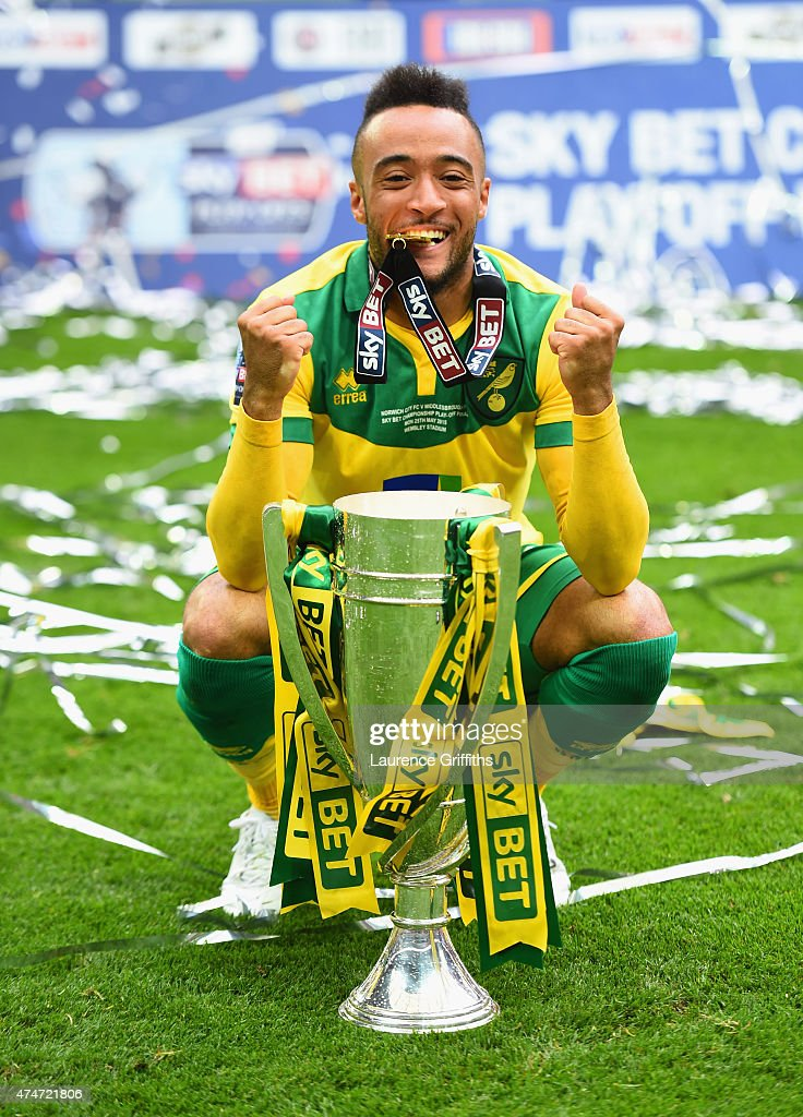 Goalscorer Nathan Redmond of Norwich City celebrates with the trophy after the Sky Bet Championship Playoff Final between Middlesbrough and Norwich City at Wembley Stadium on May 25, 2015 in London, England. Norwich City seal promotion to the Premier League with a 2-0 victory