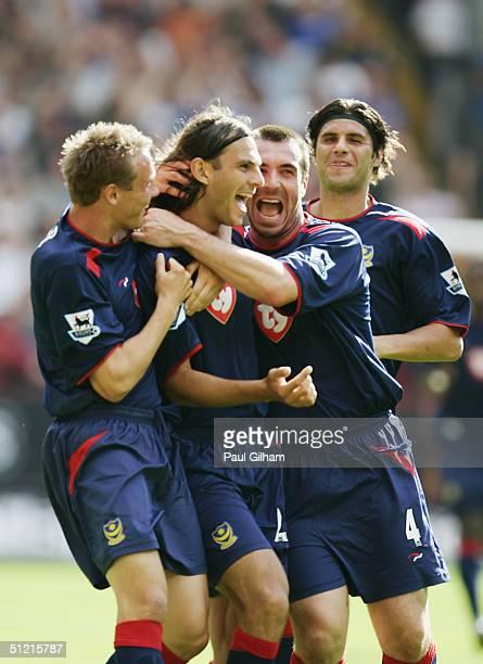 Goalscorer Patrick Berger celebrates with Portsmouth team mates Matthew Taylor, David Unsworth and Dejan Stefanovic during the Barclays Premiership...