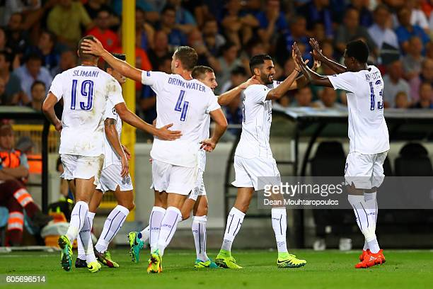 Goalscorer Riyad Mahrez of Leicester City celebrates with teammates during the UEFA Champions League match between Club Brugge KV and Leicester City...
