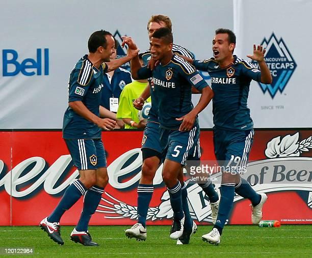 Goalscorer Sean Franklin of the Los Angeles Galaxy is congratulated by teammates Landon Donovan Juninho and Adam Cristman during their MLS game...