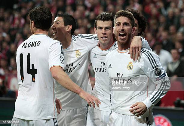 Goalscorer Sergio Ramos celebrates with Xabi Alonso Angel Di Maria and Gareth Bale of Real Madrid after his first goal during the UEFA Champions...