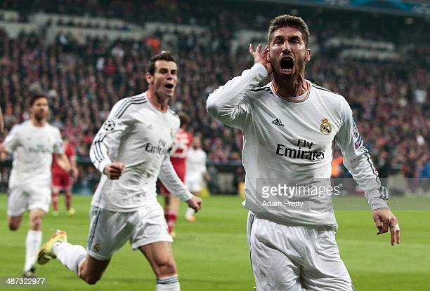 Goalscorer Sergio Ramos of Real Madrid celebrates his first goal with Gareth Bale during the UEFA Champions League semifinal second leg match between...