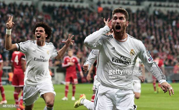 Goalscorer Sergio Ramos of Real Madrid celebrates his first goal with Pepe during the UEFA Champions League semifinal second leg match between FC...