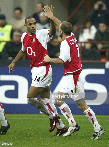 Goalscorer Thierry Henry congratulates Fredrik Ljungberg of Arsenal after he scores their second goal during the UEFA Champions League Group B match...