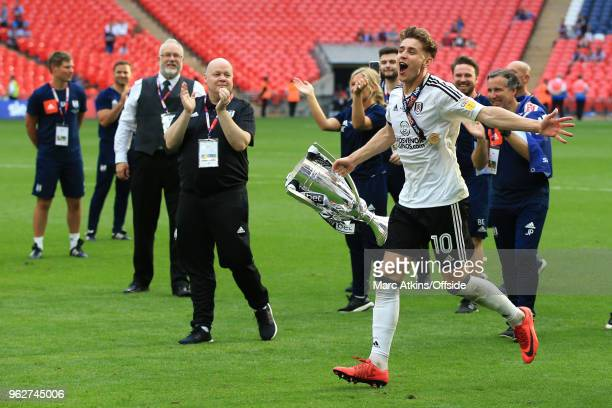 Goalscorer Tom Cairney of Fulham celebrates with the trophy during the Sky Bet Championship Play Off Final between Aston Villa and Fulham at Wembley...