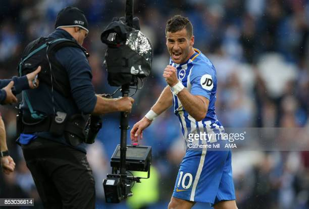 Goalscorer Tomer Hemed of Brighton and Hove Albion celebrates for the television camera after the Premier League match between Brighton and Hove...