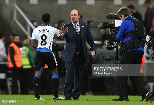 Goalscorer Vurnon Anita of Newcastle United is congratulated by Rafael Benitez the manager of Newcastle United following the final whistle during the...