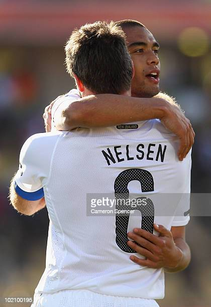 Goalscorer Winston Reid of New Zealand celebrates with Ryan Nelsen at the final whistle during the 2010 FIFA World Cup South Africa Group F match...