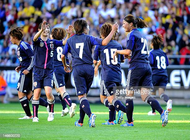 Goalscorer Yuki Nagasato of Japan is congratulated by teammates during the Women's Volvo Winners Cup match between Sweden and Japan at Gamla Ullevi...