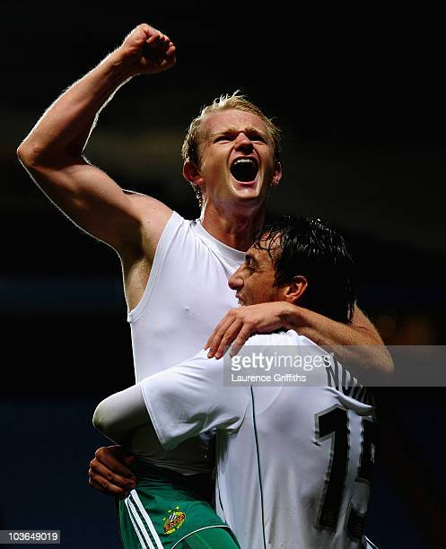 Goalscorers Mario Sonnleitner and Atdhe Nuhiu of SK Rapid Vienna celebrate on the fianl whistle during the UEFA Europa League play off second leg...