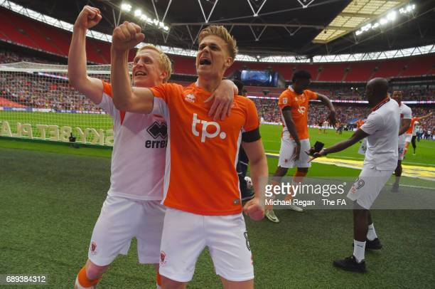 Goalscorers Mark Cullen and Brad Potts of Blackpool celebrate victory and promotion after the Sky Bet League Two Playoff Final between Blackpool and...